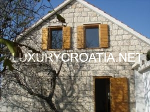 Renovated, stone house for sale in Mimice with a sea view